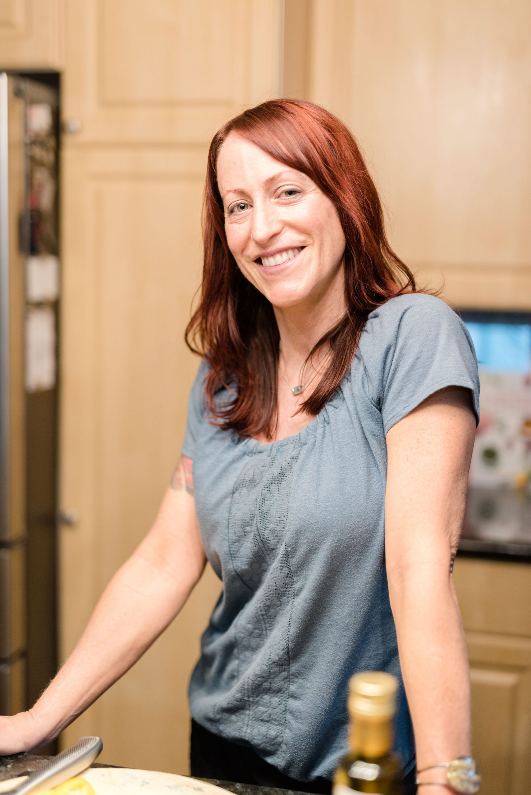 Picture of Maria leaning on kitchen counter